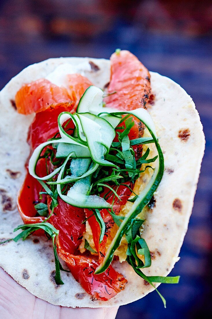 Gravlax salmon, thinly sliced cucumbers and fresh herbs