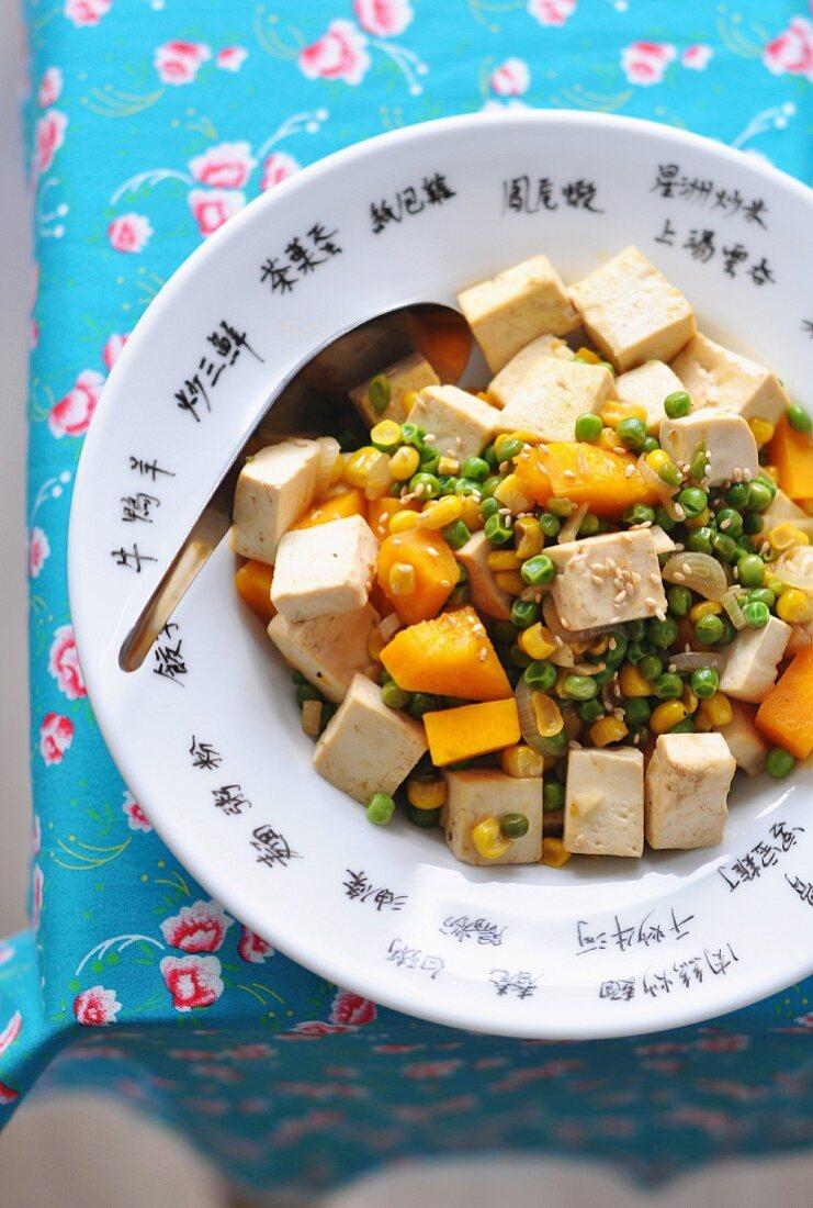 Asian-style mixed peas, tofu, sweetcorn and pumpkin sauté