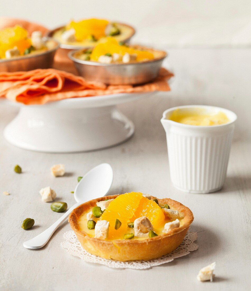 Lemon curd, orange segment, crushed pistachio and nougat tartlet