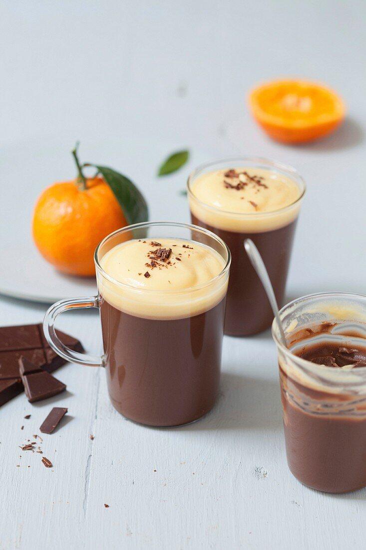 Dark chocolate cream dessert with clementine emulsion