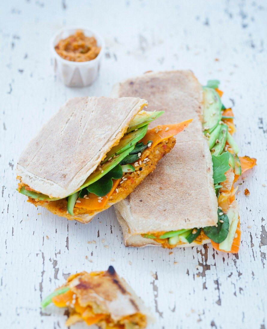 Raw carrot, cucumber, baby spinach, avocado, sesame, cashew spread with tomatoes, honey spicy panini