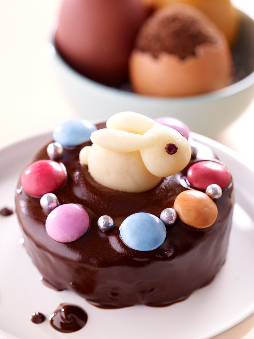 Small chocolate and coconut brownie decorated with an almond paste rabbit