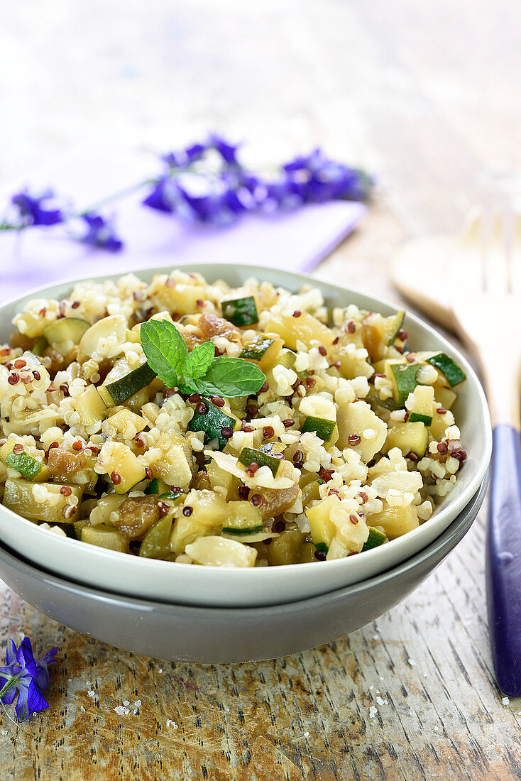 Quinoa,courgettes caramelized in agava syrup, thinly slice almond and mint salad