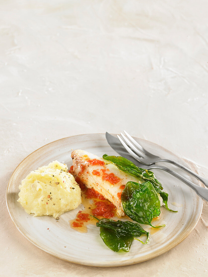 Coley fillet with crushed tomatoes and basil, mashed potatoes