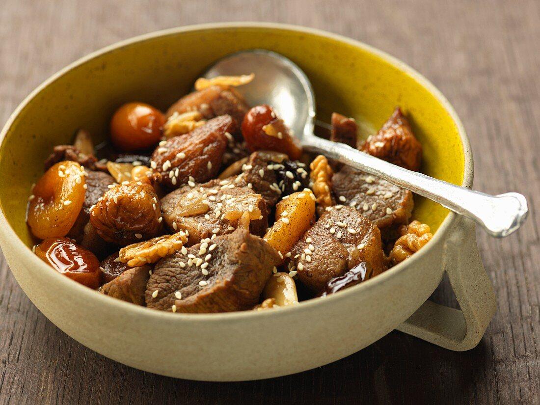 Lamb, sesame, walnut, dried fig, dried apricot, prune and date Tajine