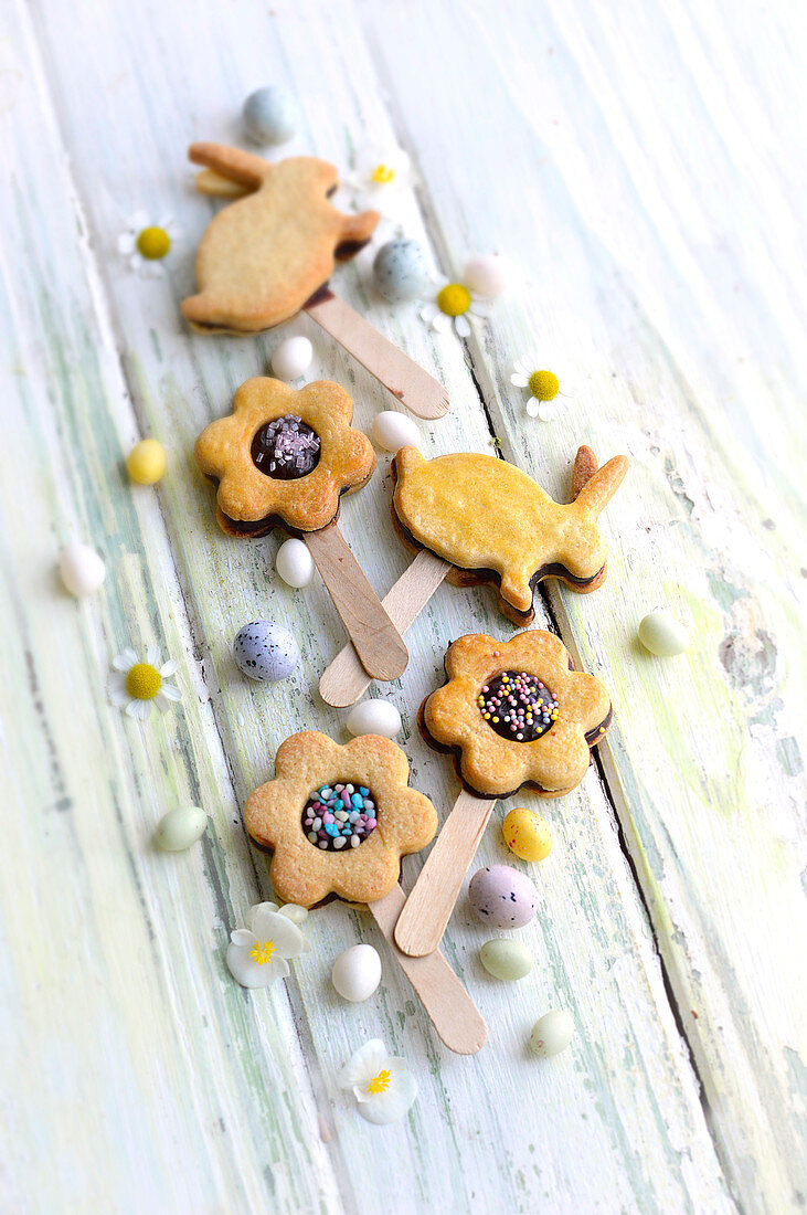 Flower and rabbit-shaped Easter chocolate shortbread lollipops