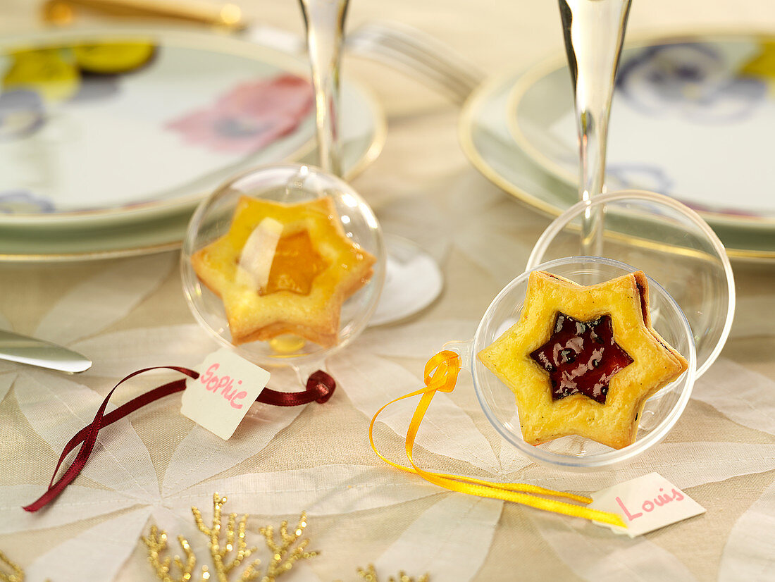 Star-Shaped Apricot And Summer Berry Jam Biscuits In Transparent Christmas Ball With Name Tags