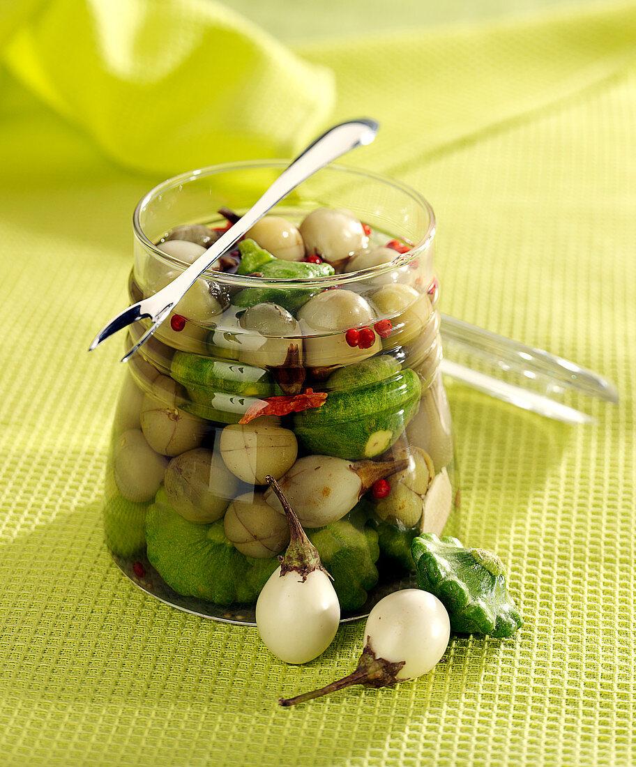 Pickled mini custard marrows and round white mini aubergines