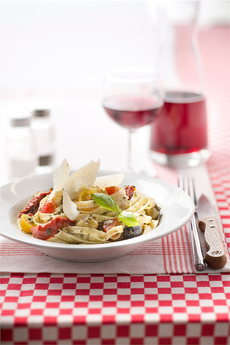Tagliatelles with pesto,confit tomatoes,cherry tomatoes, olives and parmesan flakes