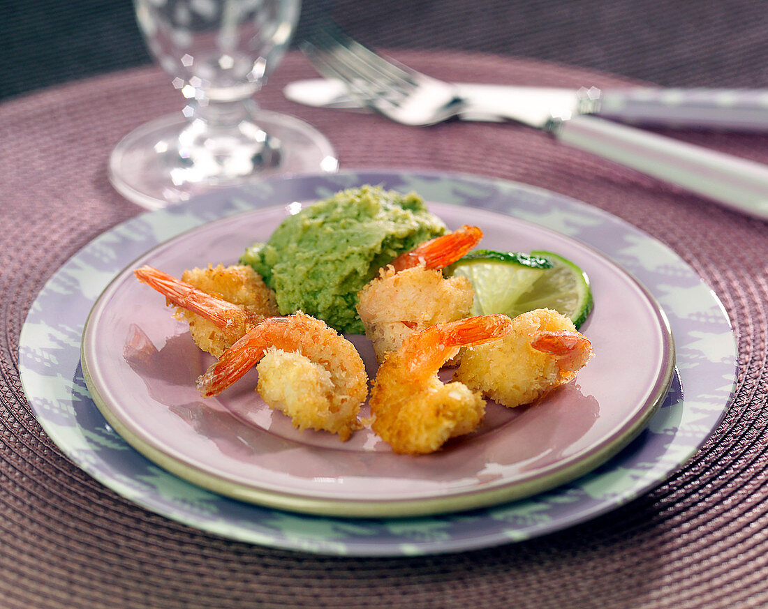 Shrimps breaded with grated coconut, broccoli puree