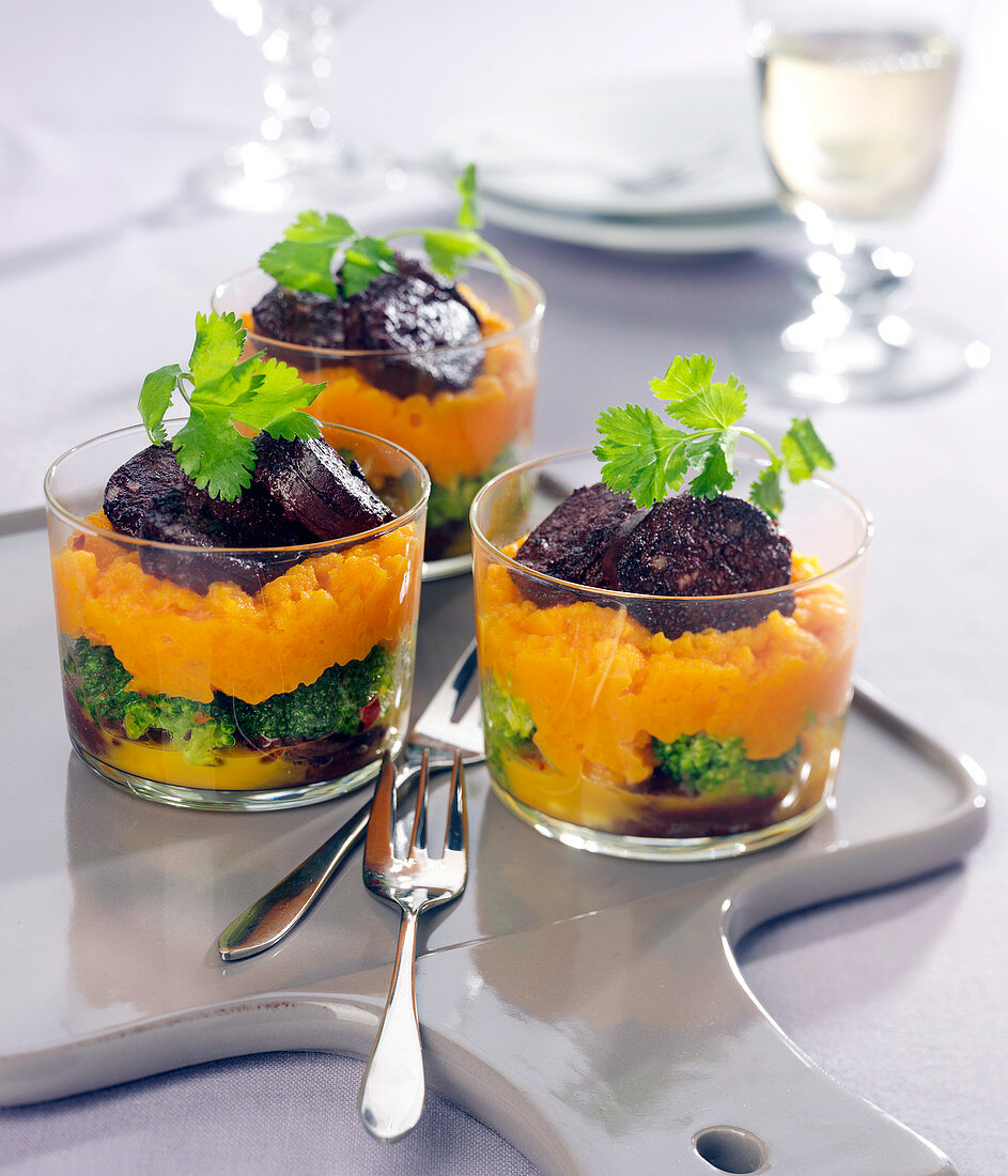 Black pudding with carrot and broccoli puree