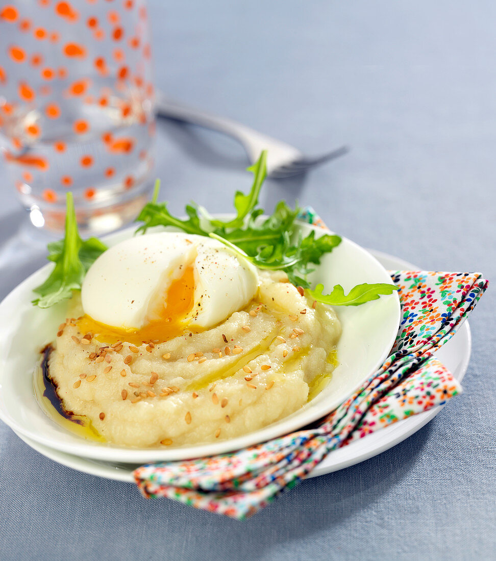 Celeriac mash with sesame seeds topped with a soft-boiled egg