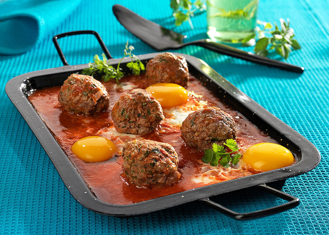 Kefta with eggs and tomato sauce