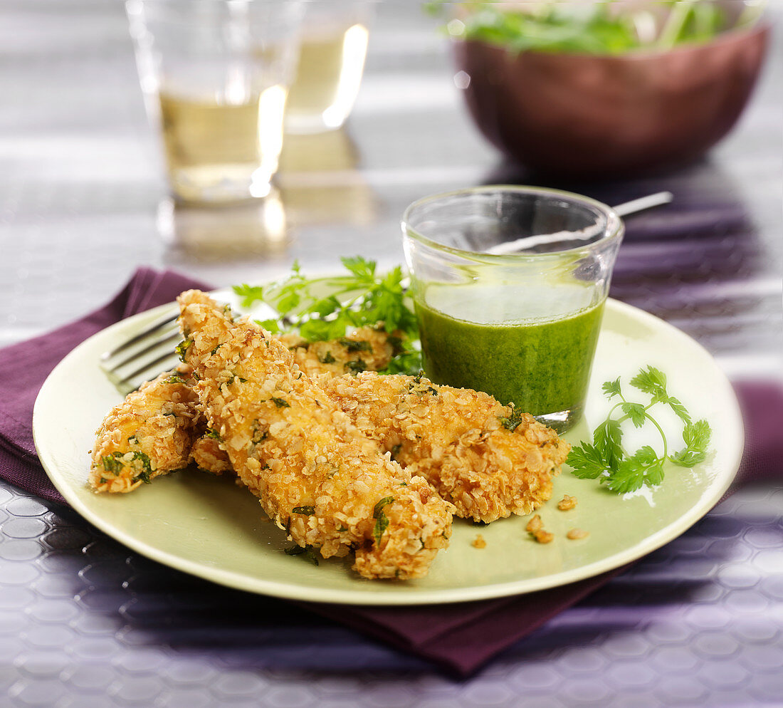 Chicken wings coated in oat flakes and herbs, rocket lettuce sauce