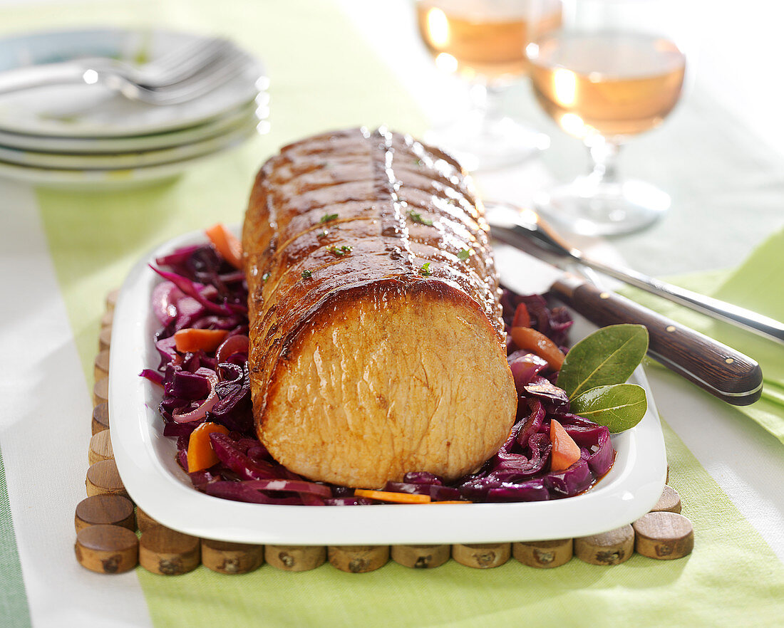 Braised pork roast, red cabbage and carrots