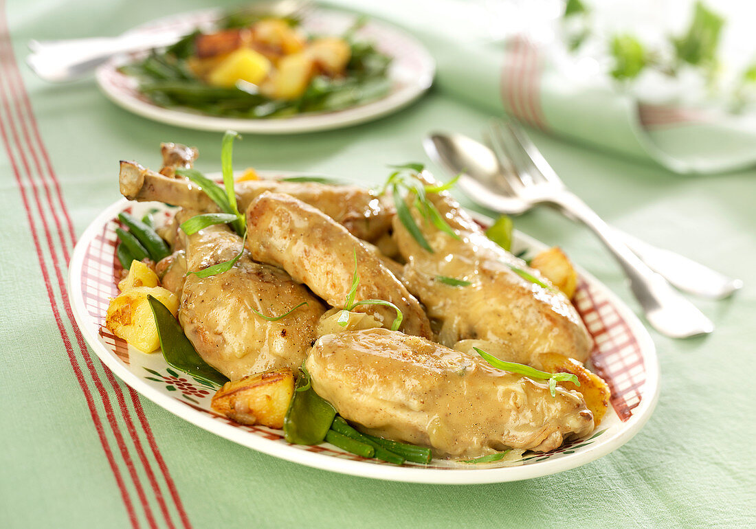Chicken with tarragon, potatoes sauté, green beans and steamed sweet peas