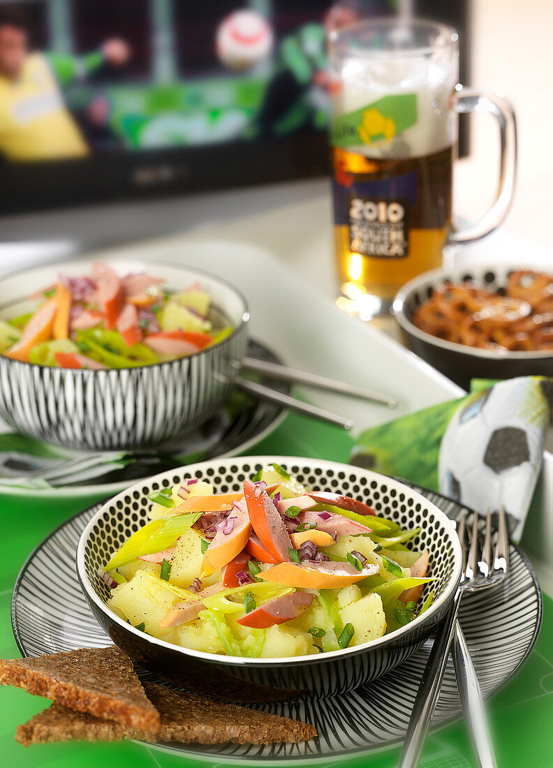 Potato, francfort sausage, leek and German red onion salad