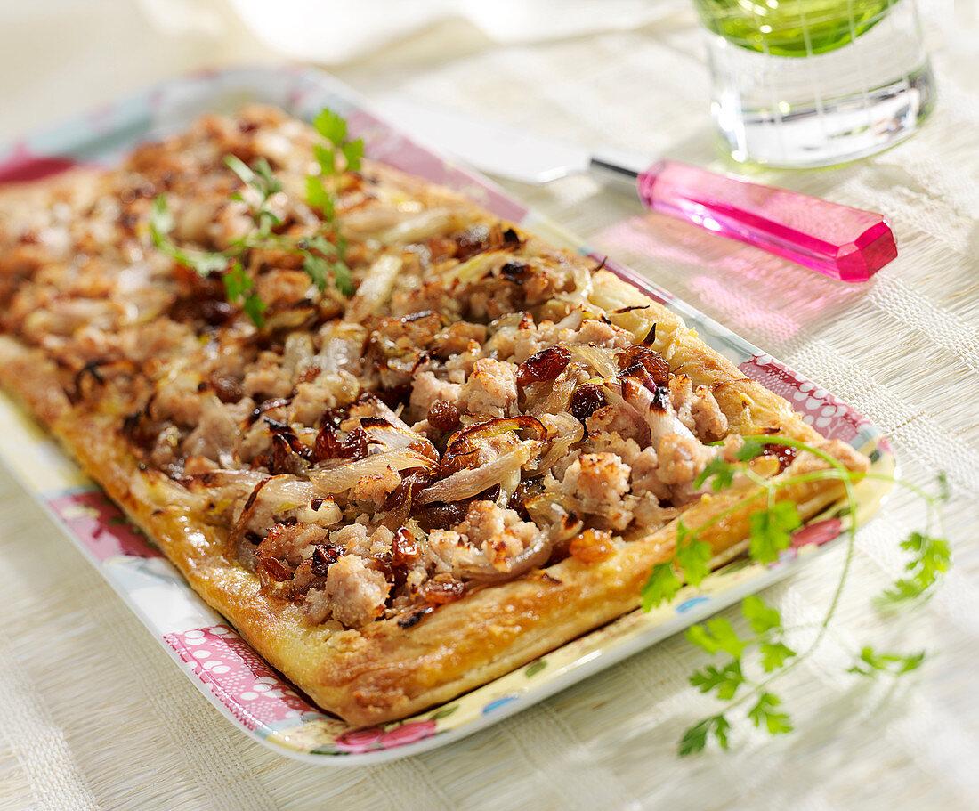 Ground pork, shallot and raisin tart