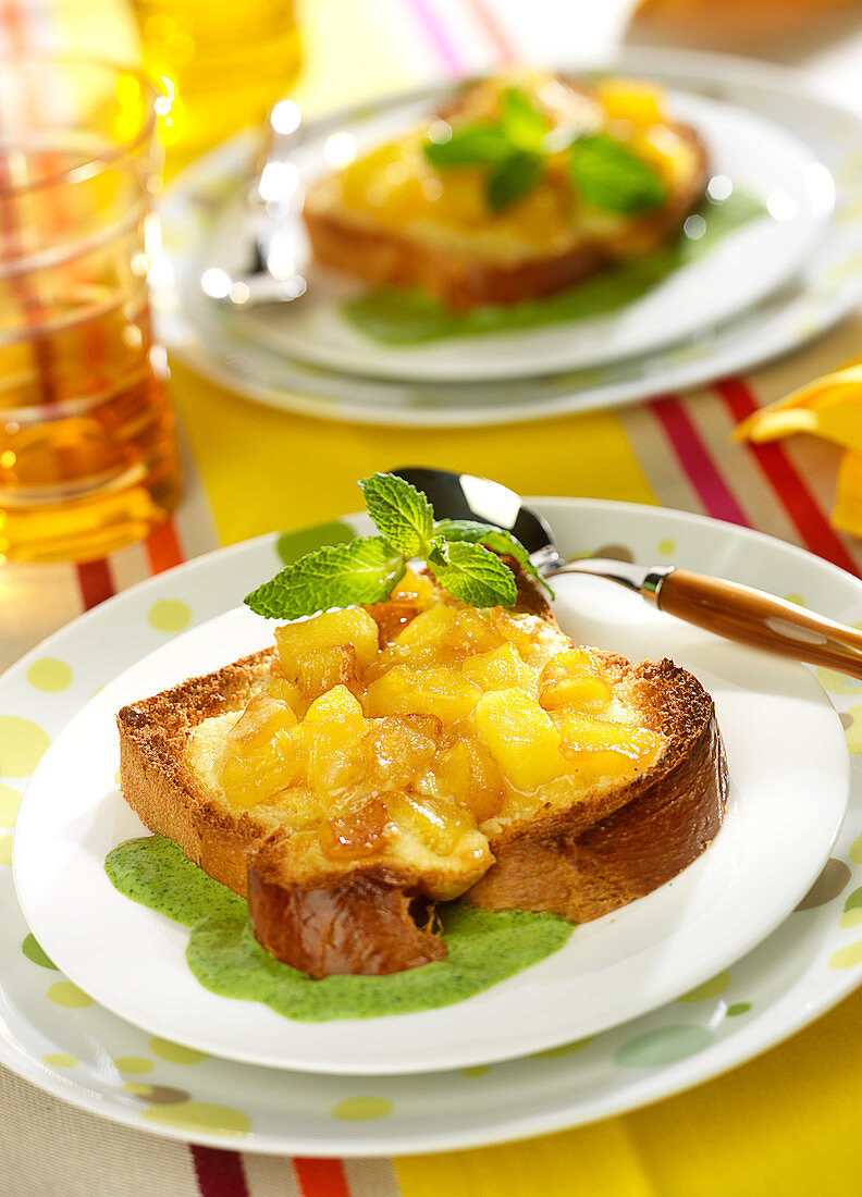 Slice of toasted brioche topped with caramelized apples