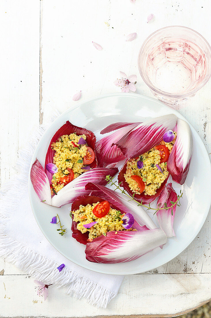 Red chicory leaves garnished flowery tabbouleh