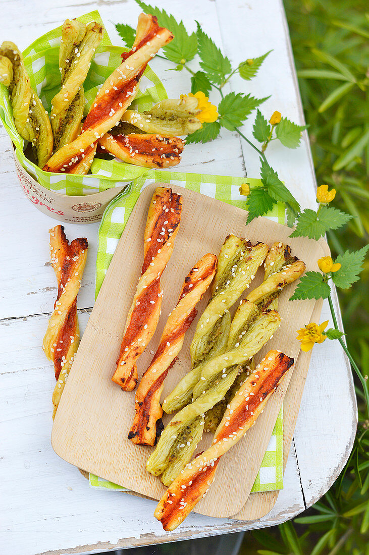 Two pesto twist finger appetizers outdoors