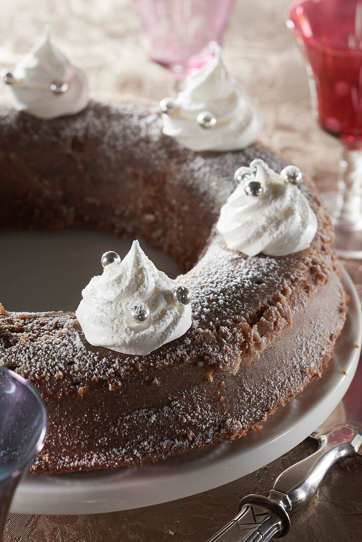 Moelleux with chocolate and chestnut cream, decorated with meringuettes and silver sugar balls