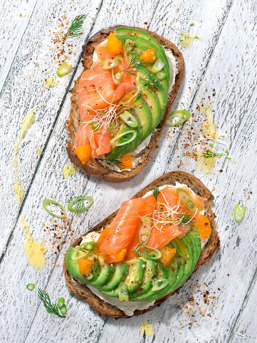 Cream cheese, avocado, smoked salmon, marinade, spring onion and rocket lettuce sprout toasts