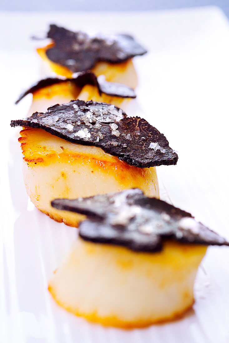 Salmon and truffle snacks with a pinch of sea salt