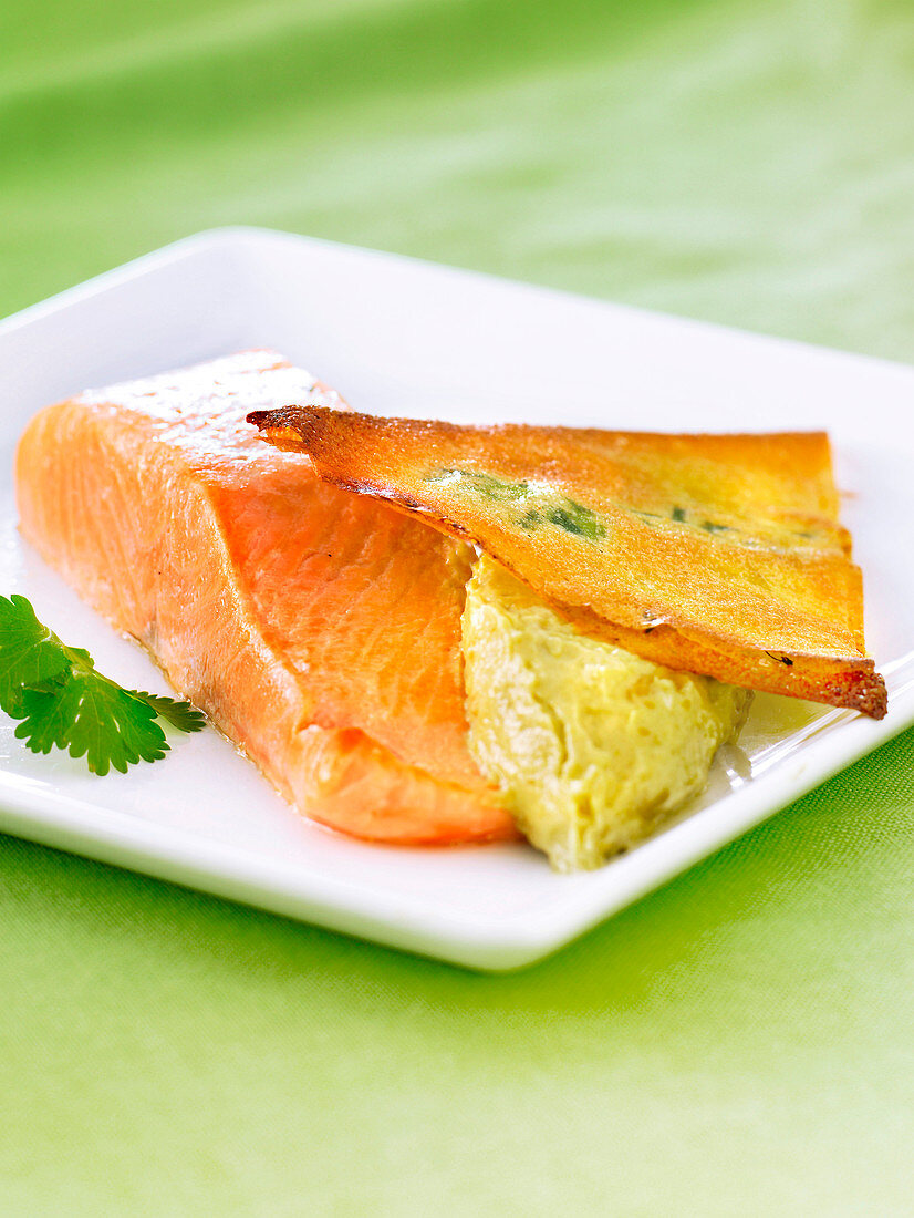 Salmon steak, light vegetable mousse and a crisp herb tuile