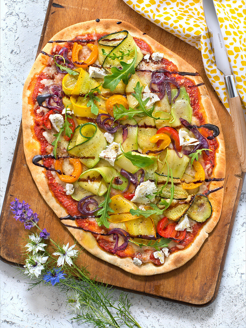Courgette,Tomato,Pepper,Red Onion,Rocket Lettuce And Feta Pizza With Balsamic Vinegar