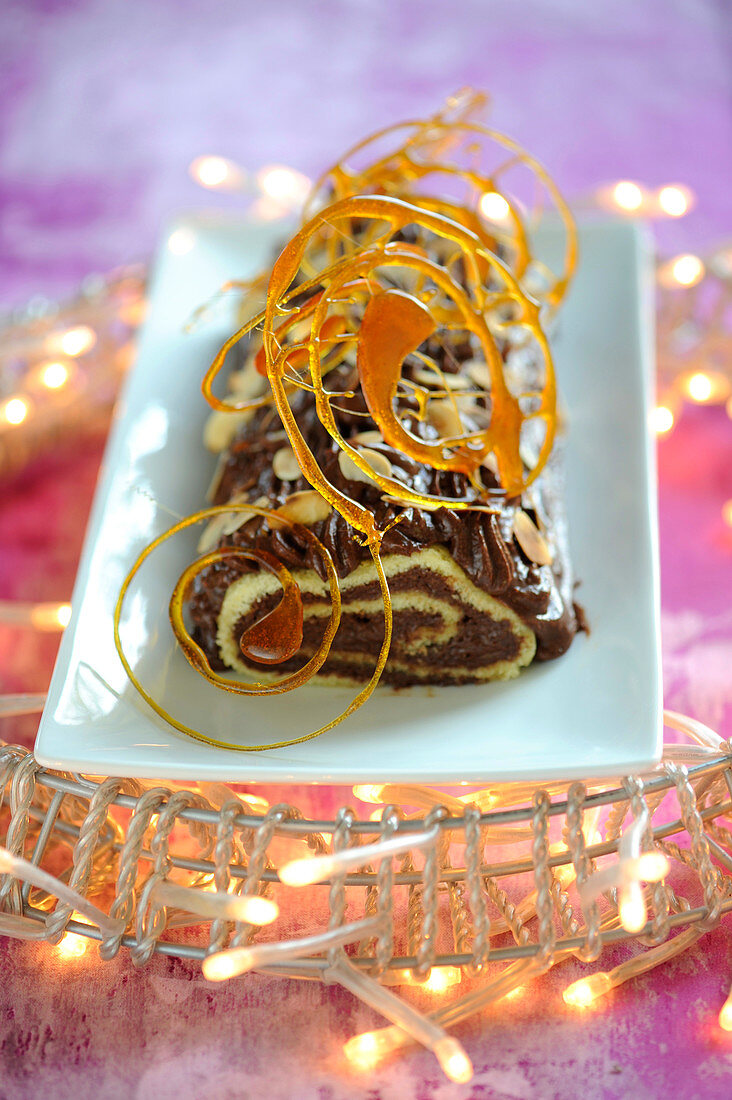 Chocolate,almond and caramel twirl Christmas log cake