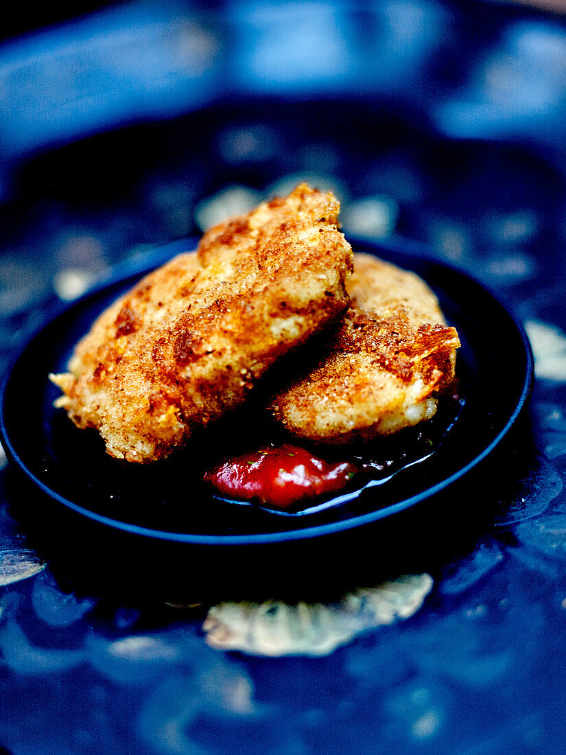 Homemade white fish nuggets with barbecue sauce