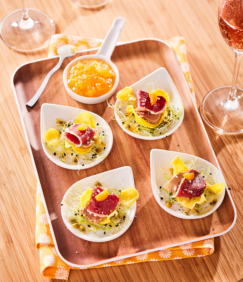 Foie gras,duck breast and alfafa appetizers with mango chutney