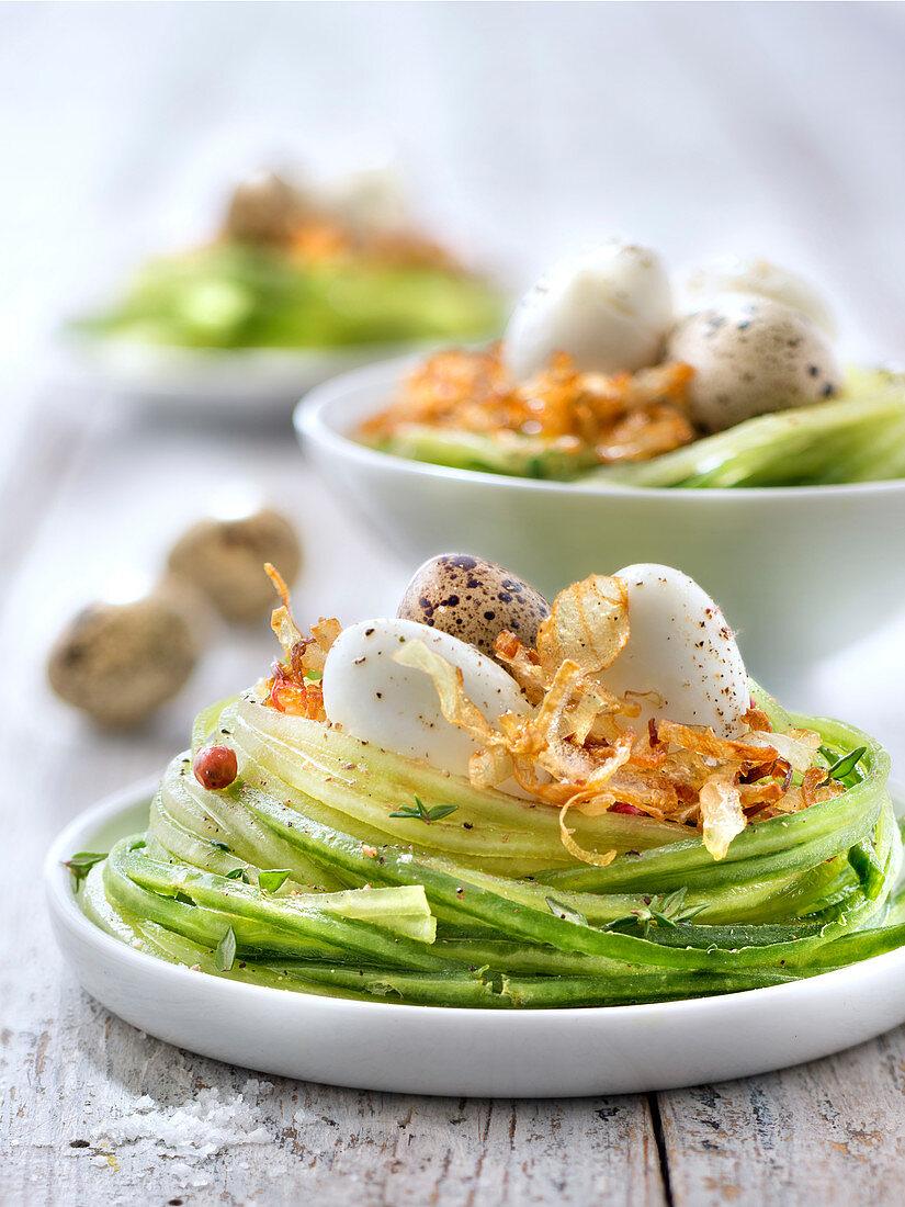 Cucumber spaghettis nest,quail's eggs and fried onions