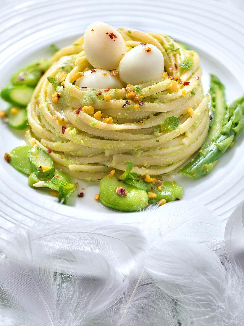 Pistachio pesto linguini nest,fresh broad beans,asparagus and quail's eggs