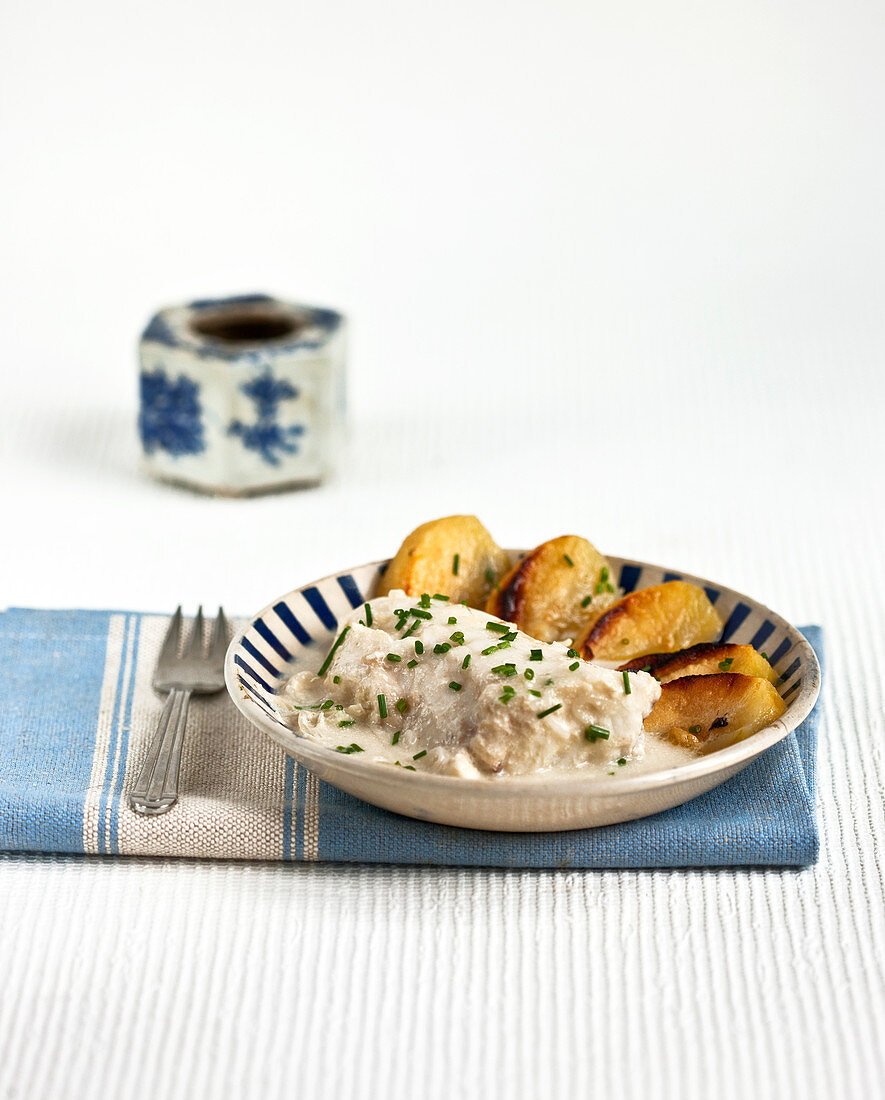 Piece of monkfish cooked with cider and apples