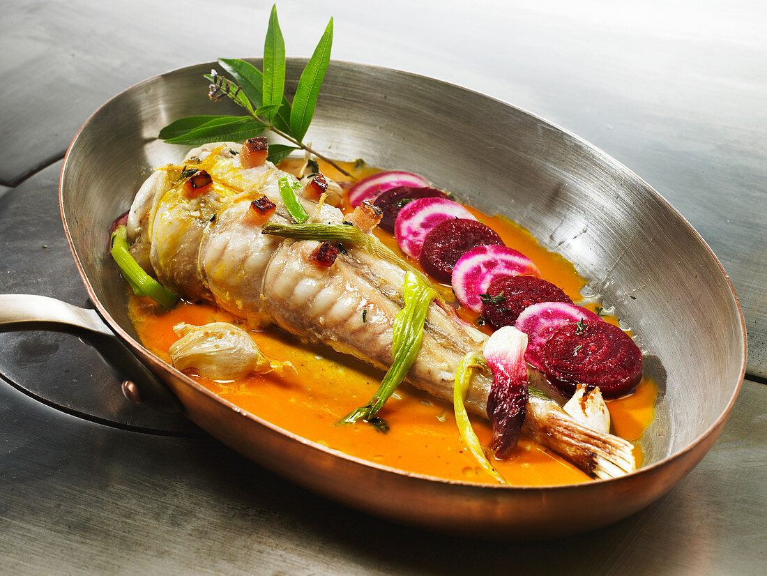 Monkfish tail pricked with streaky bacon, shellfish Bisque and beetroots
