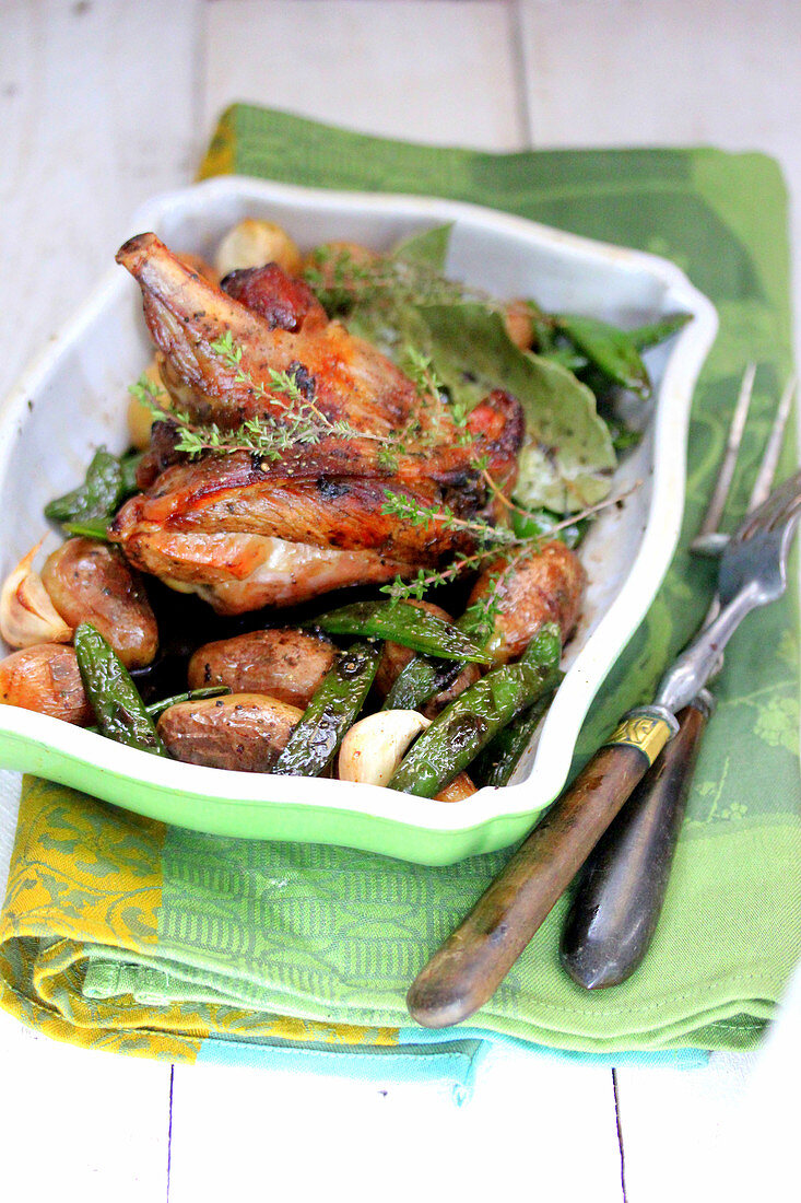 Oven roasted rabbit with sugar peas,Grenaille potatoes and thyme