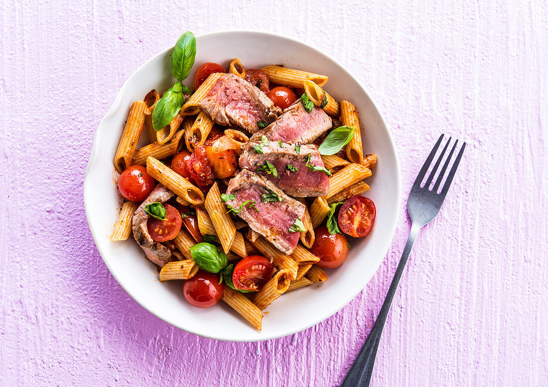 Penne pomodoro with beef steak