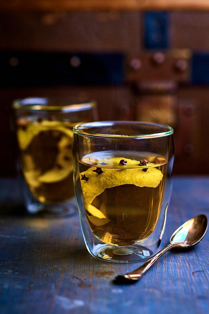 Herbal tea with lemon and clove