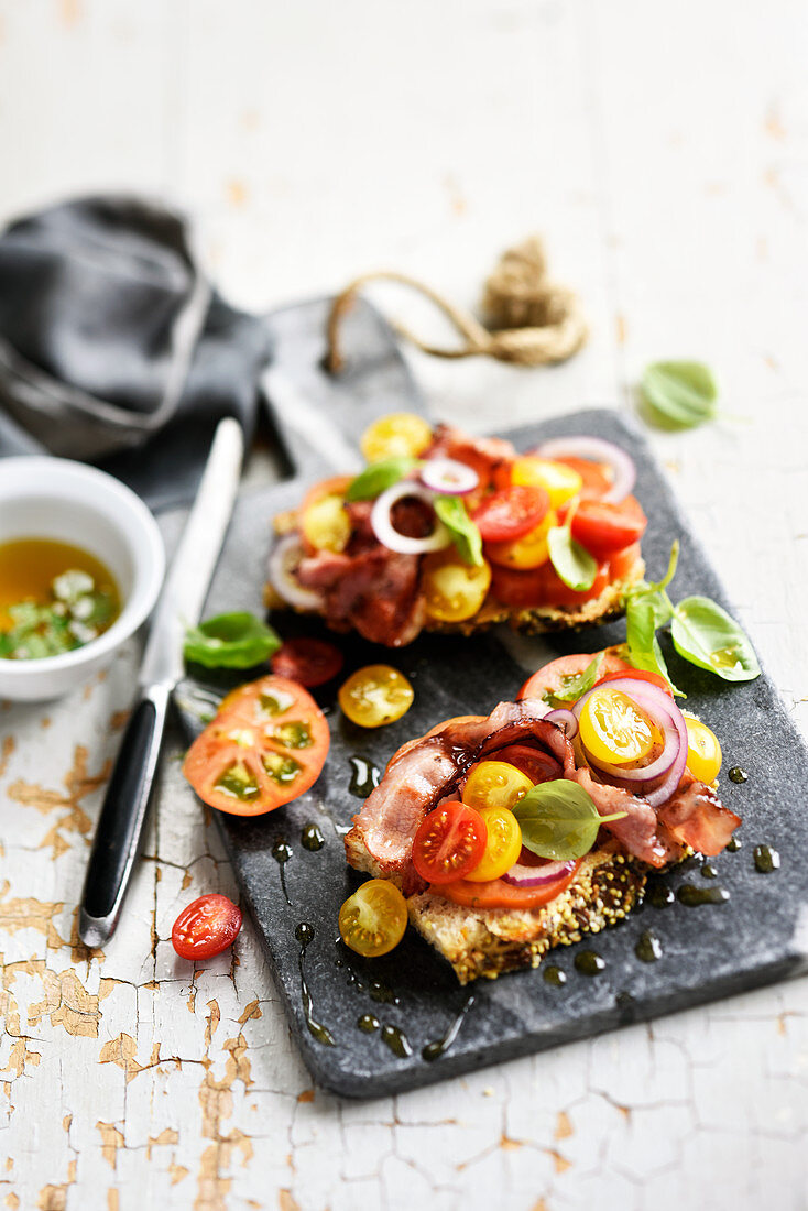 Grilled bacon,tomato,onion and basil crostinis