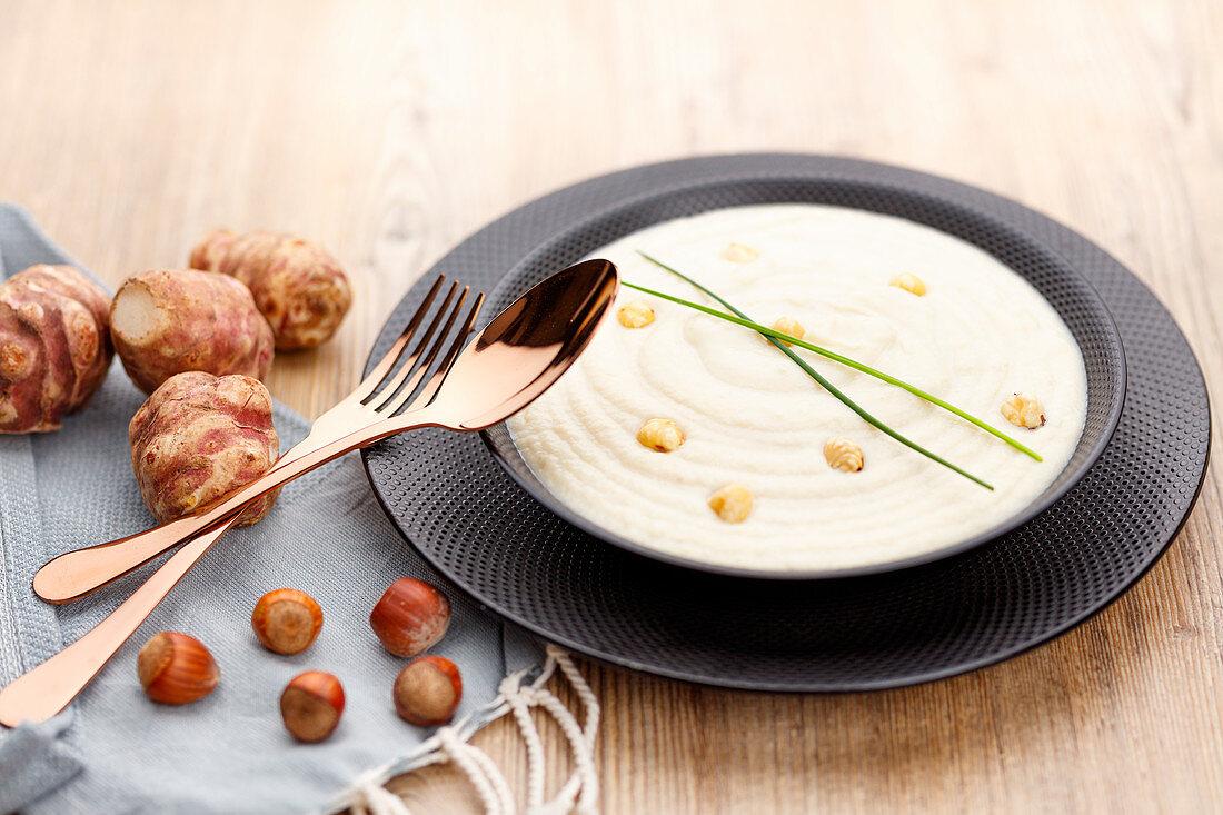 Cream of jerusalem artichoke soup with hazelnuts