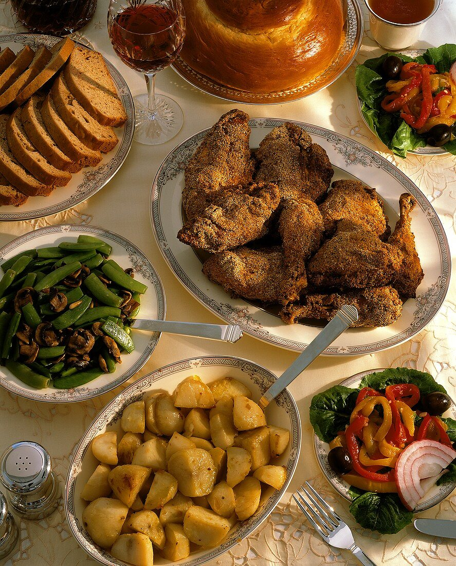 Buffet of grilled chicken, potatoes, salad, honey cake, string beans, wine, & bread