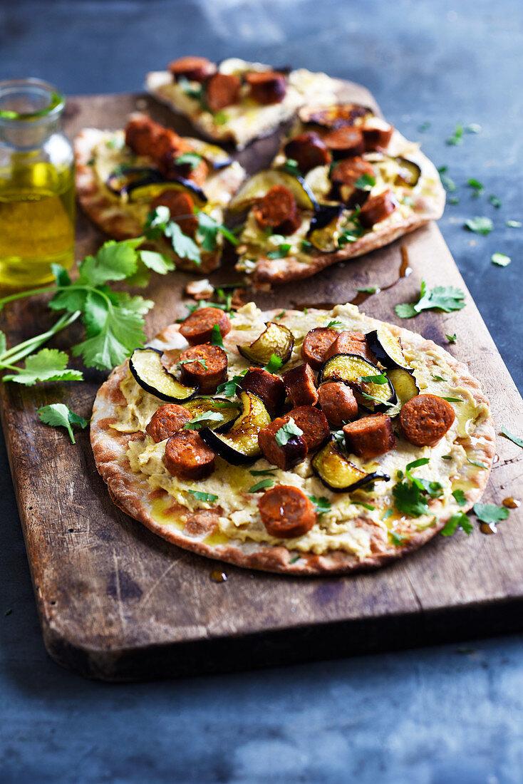 Hummus,merguez,aubergine and coriander pita pizza