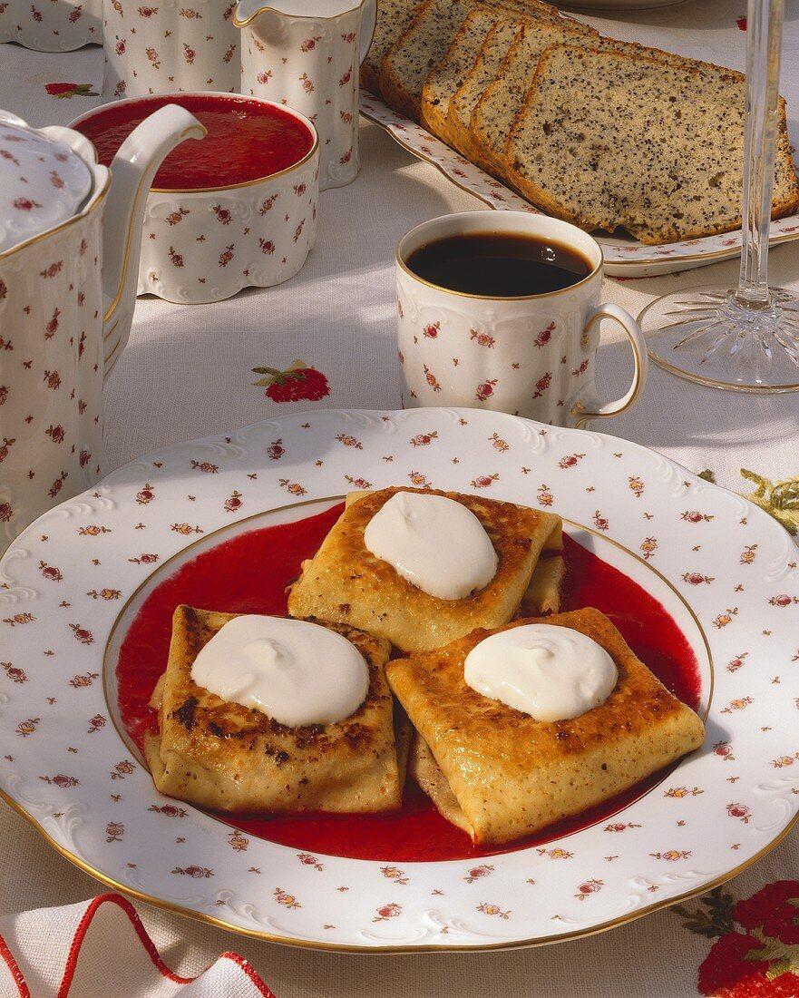Cheese Blitzes with Cream and Raspberry Sauce