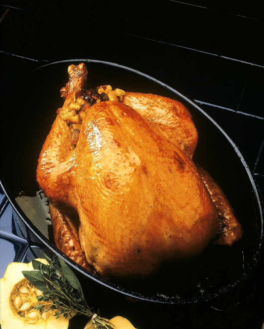 Roast Turkey with Bread Stuffing in Roasting Pan