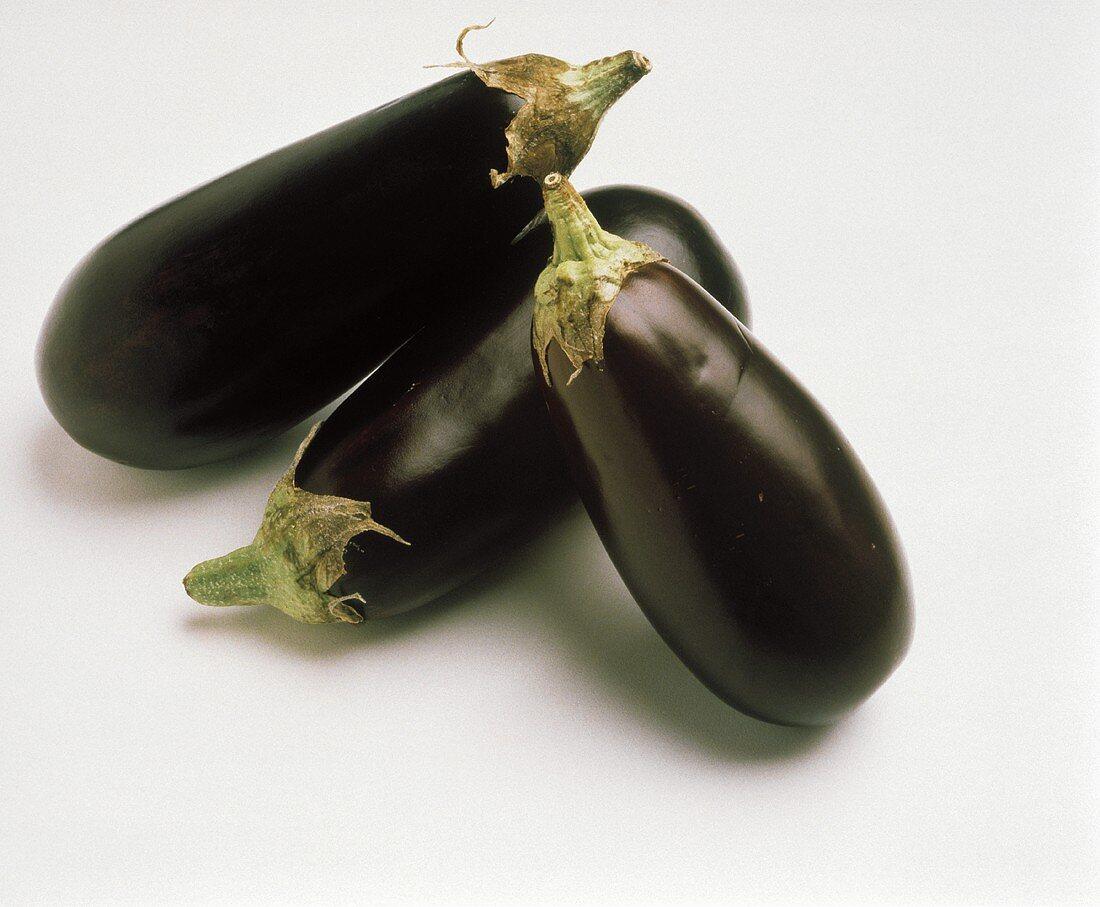 Three Whole Purple Eggplants