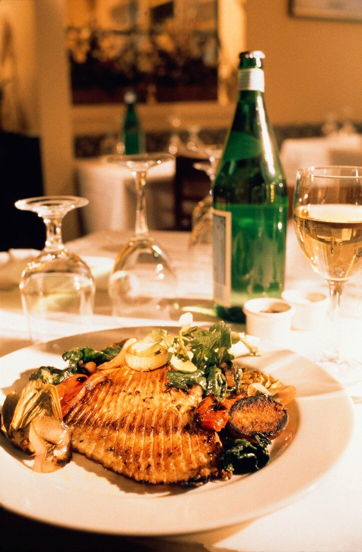 Restaurant Table Setting with Fish and Vegetables