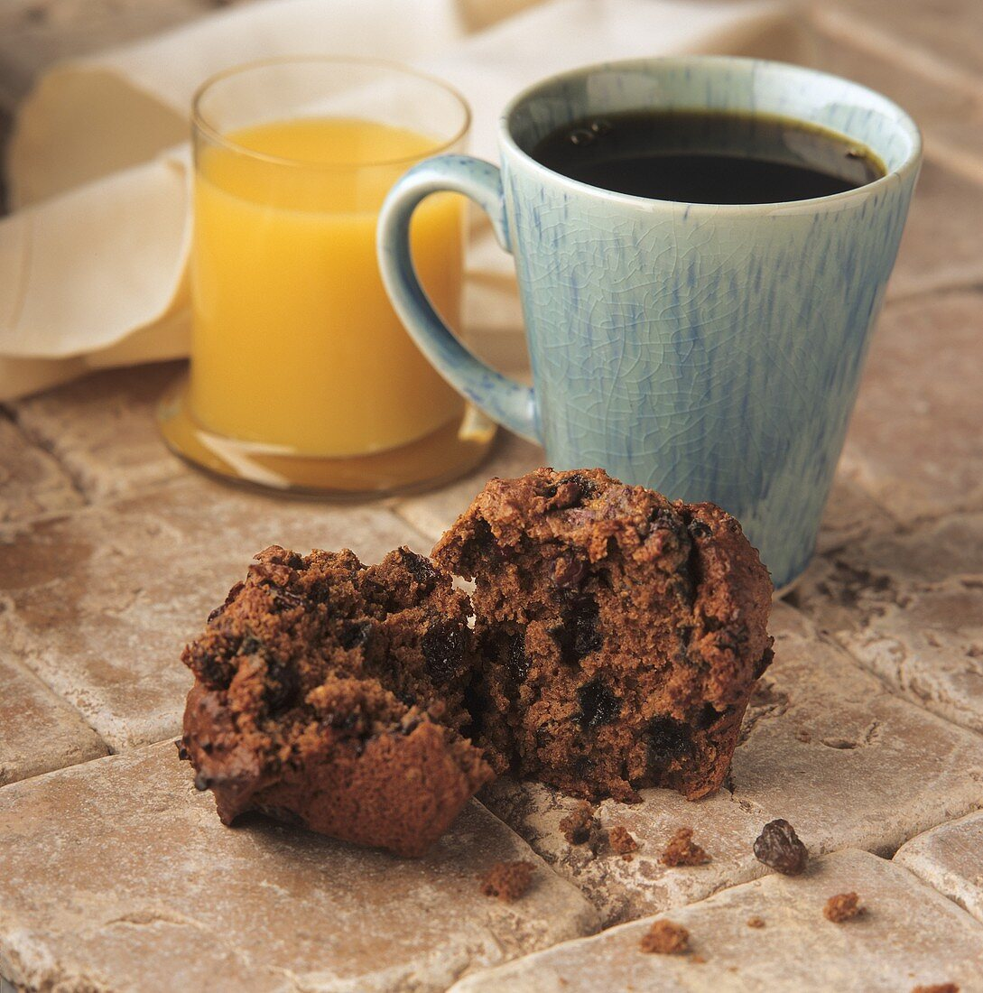 Cinnamon Raisin Muffin with Coffee and Orange Juice