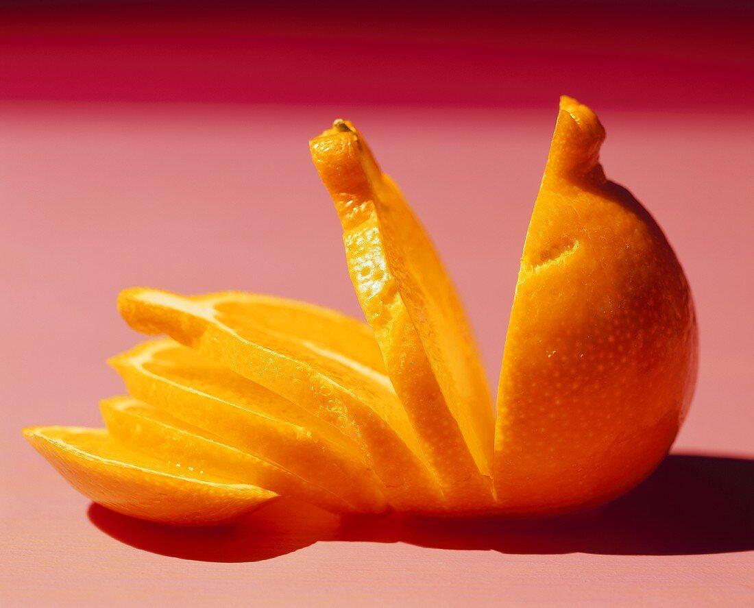Sliced Orange on Pink Background